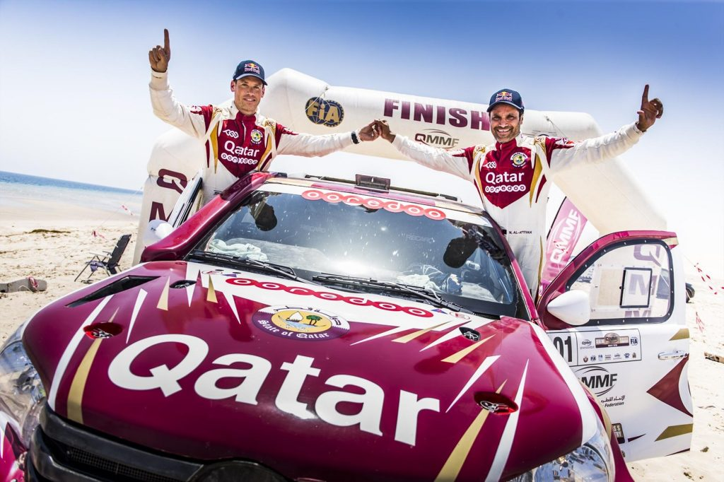 we-are-the-champions-nasser-saleh-al-attiyah-and-matthieu-baumel-celebrate-the-sealine-win_1800x1800