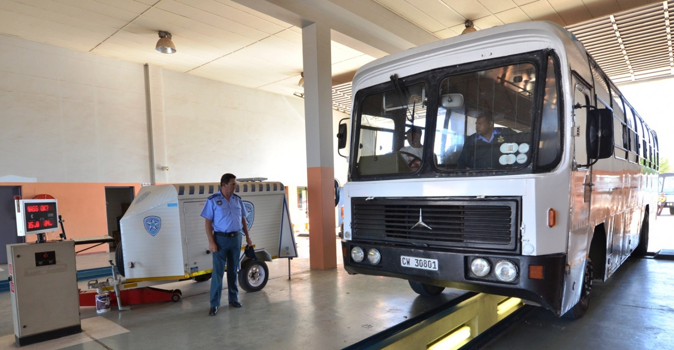 traffic-officers-inspect-a-bus-at-the-breederivier-traffic-testing-centre